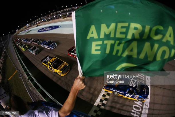 Chase Briscoe driver of the Cooper Standard Ford leads the field past the green flag to start the NASCAR Camping World Truck Series Championship Ford...