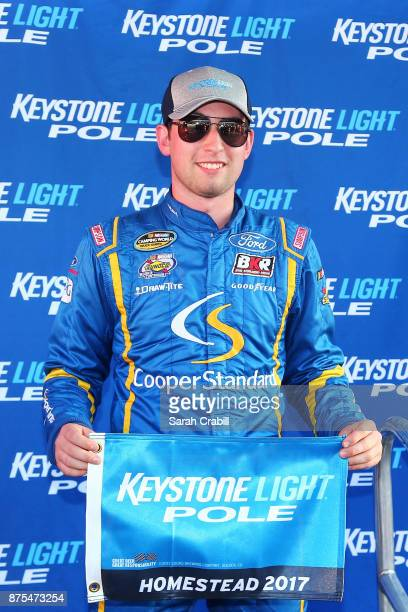 Chase Briscoe driver of the Cooper Standard Ford poses with the Keystone Light Pole Award after qualifying in the pole position for the NASCAR...