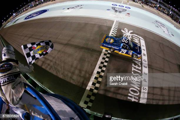 Chase Briscoe driver of the Cooper Standard Ford takes the checkered flag to win the NASCAR Camping World Truck Series Championship Ford EcoBoost 200...