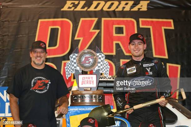 Chase Briscoe driver of the Ford Ford and track owner Tony Stewart pose with the trophy after the NASCAR Camping World Truck Series Eldora Dirt Derby...