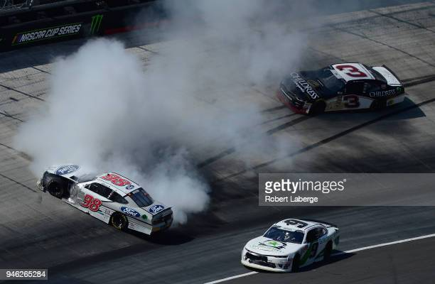 Chase Briscoe driver of the Ford Ford is involved in an ontrack incident during the NASCAR Xfinity Series Fitzgerald Glider Kits 300 at Bristol Motor...