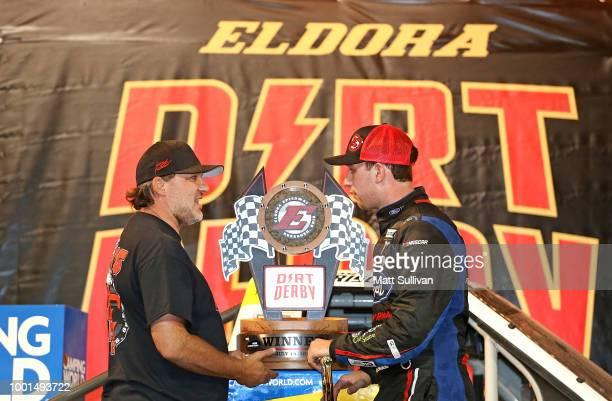 Chase Briscoe driver of the Ford Ford talks with track owner Tony Stewart pose with the trophy after the NASCAR Camping World Truck Series Eldora...