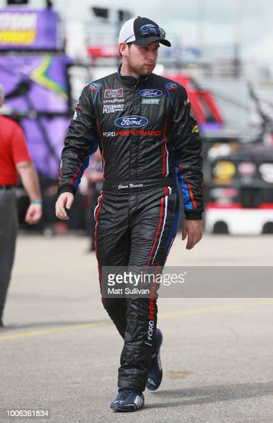 Chase Briscoe driver of the Ford Ford walks to his car during practice for the NASCAR Xfinity Series US Cellular 250 Presented by Rasmussen Group at...