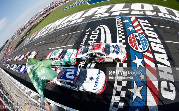 Chase Briscoe driver of the Ford Performance Ford and Tyler Reddick driver of the Emerson Chevrolet lead the field to the green flag start of the...