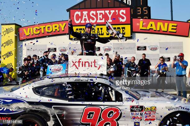 Chase Briscoe driver of the Ford Performance Ford celebrates in victory lane after winning the NASCAR Xfinity Series US Cellular 250 at Iowa Speedway...