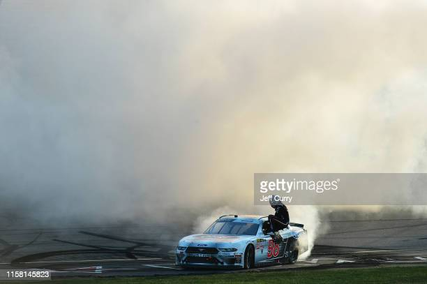 Chase Briscoe driver of the Ford Performance Ford celebrates with a burn out after winning the NASCAR Xfinity Series US Cellular 250 at Iowa Speedway...