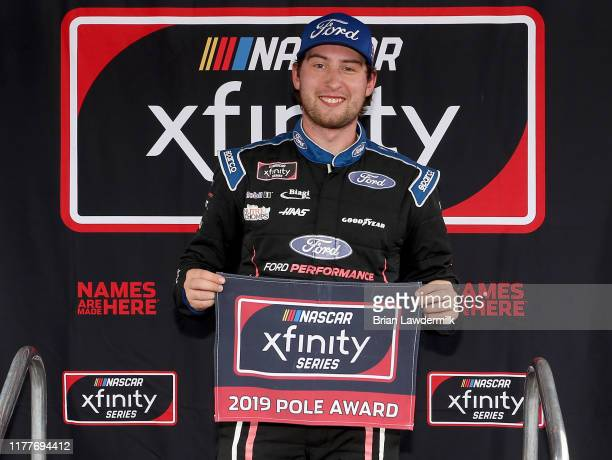 Chase Briscoe driver of the Ford Performance Ford celebrates with the Pole Award after qualifying for the NASCAR Xfinity Series Drive for the Cure...