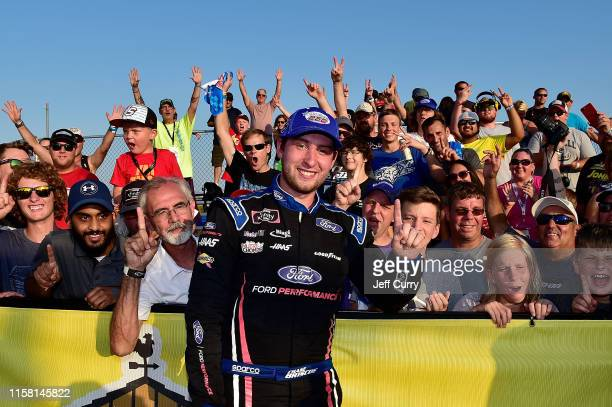 Chase Briscoe, driver of the Ford Performance Ford, poses for a photo with fans after winning the NASCAR Xfinity Series U.S. Cellular 250 at Iowa...