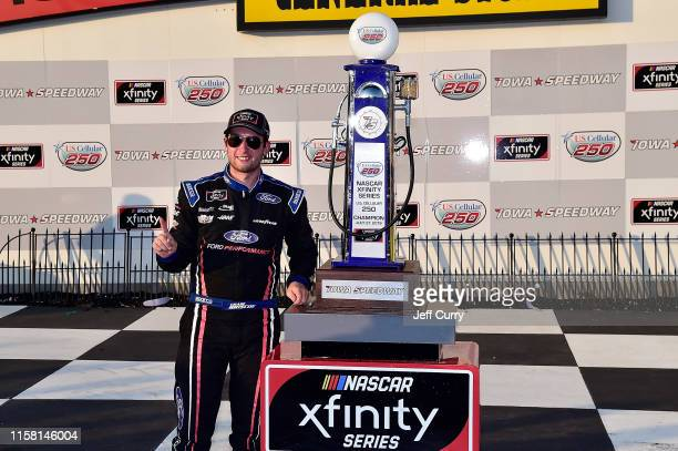 Chase Briscoe, driver of the Ford Performance Ford, poses for a photo after winning the NASCAR Xfinity Series U.S. Cellular 250 at Iowa Speedway on...