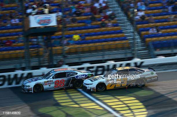 Chase Briscoe, driver of the Ford Performance Ford, races John Hunter Nemechek, driver of the Chevy Accessories Chevrolet, during the NASCAR Xfinity...