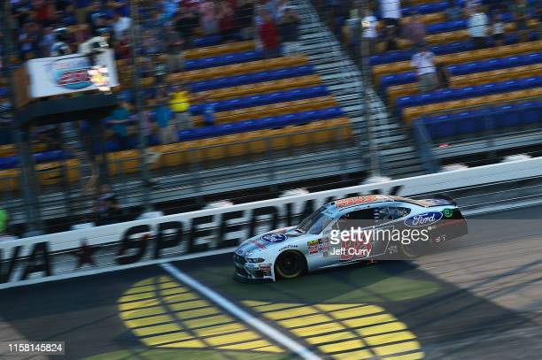 Chase Briscoe driver of the Ford Performance Ford takes the checkered flag to win the NASCAR Xfinity Series US Cellular 250 at Iowa Speedway on July...
