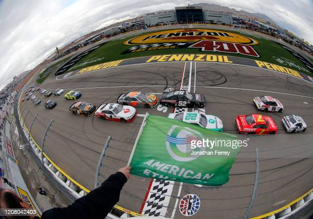 Chase Briscoe, driver of the Ford Performance Racing School Ford, leads the field to the green flag at the start of the NASCAR Xfinity Series Boyd...