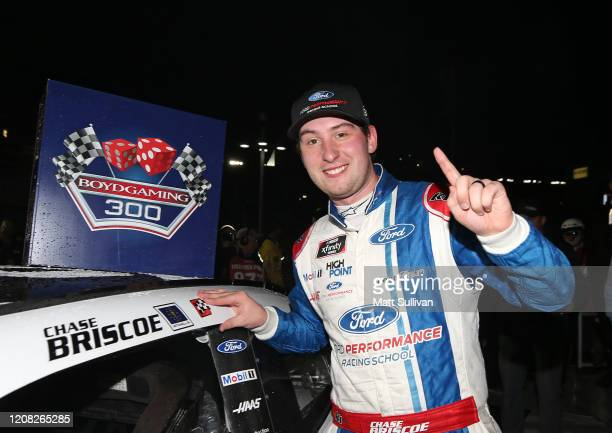 Chase Briscoe driver of the Ford Performance Racing School Ford poses with the winners sticker after the rain delayed NASCAR Xfinity Series Boyd...