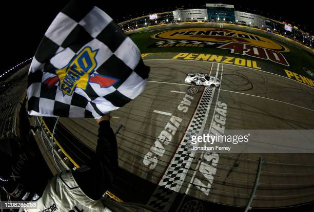 Chase Briscoe, driver of the Ford Performance Racing School Ford, takes the checkered flag to win during the NASCAR Xfinity Series Boyd Gaming 300 at...