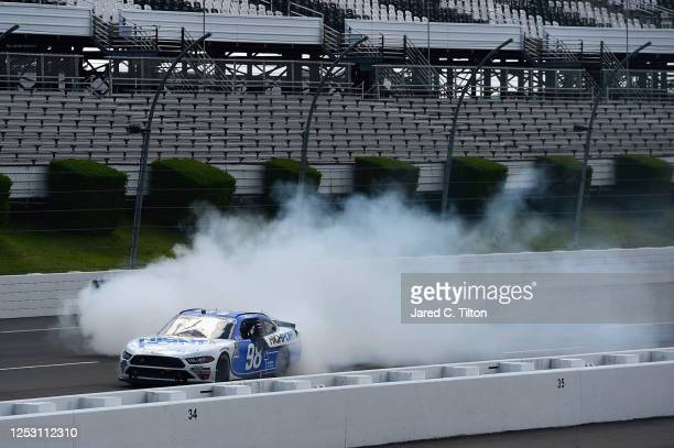 Chase Briscoe, driver of the Highpoint.com Ford, celebrates with a burnout after winning the NASCAR Xfinity Series Pocono Green 225 Recycled by J.P....
