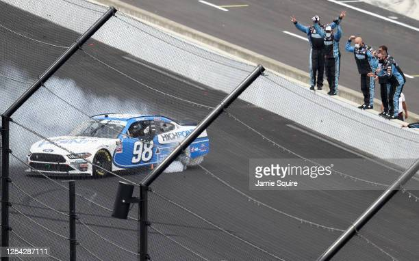 Chase Briscoe, driver of the Highpoint.com Ford, celebrates with a burnout after winning the the NASCAR Xfinity Series Pennzoil 150 at the Brickyard...