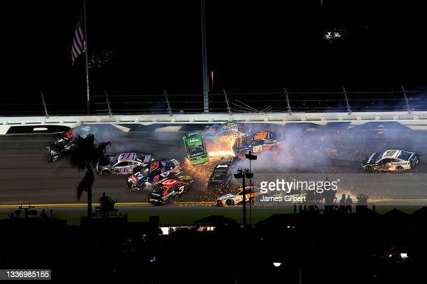 Chase Briscoe, driver of the Mobil 1 Ford, Kyle Larson, driver of the Valvoline Instant Oil Change Chevrolet, Austin Dillon, driver of the Bass Pro...