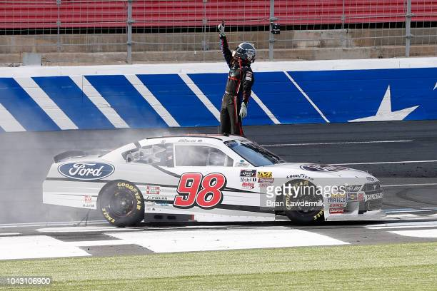 Chase Briscoe driver of the Nutri Chomps/Ford Ford celebrates after winning during the NASCAR XFINITY Series Drive for the Cure 200 at Charlotte...