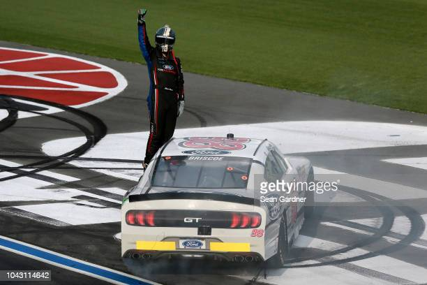 Chase Briscoe driver of the Nutri Chomps/Ford Ford celebrates after winning the NASCAR XFINITY Series Drive for the Cure 200 at Charlotte Motor...