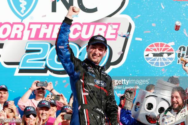 Chase Briscoe driver of the Nutri Chomps/Ford Ford celebrates in victory lane after winning the NASCAR XFINITY Series Drive for the Cure 200 at...