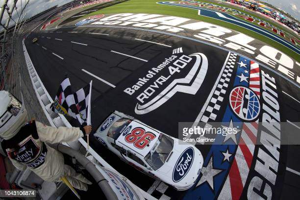 Chase Briscoe driver of the Nutri Chomps/Ford Ford crosses the finish line to win the NASCAR XFINITY Series Drive for the Cure 200 at Charlotte Motor...