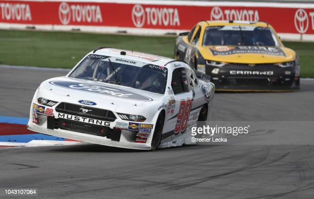 Chase Briscoe driver of the Nutri Chomps/Ford Ford races during the NASCAR XFINITY Series Drive for the Cure 200 at Charlotte Motor Speedway on...