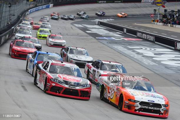 Chase Briscoe drivler of the Nutri Chompps Fordleads a pack of cars during the NASCAR Xfinity Series Alsco 300 at Bristol Motor Speedway on April 6...