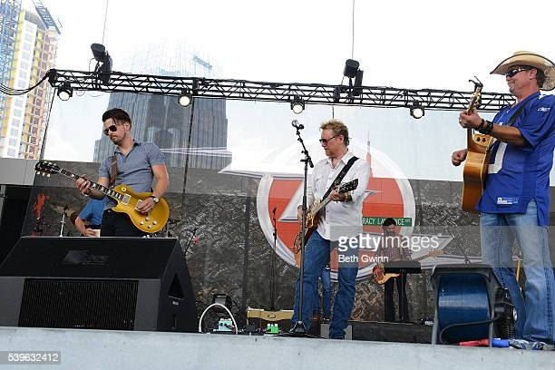 Chase Bryant Lee Roy Parnell and Tracy Lawrence perform a Merle Haggard song at the end of their show during CMA Festival at the Ascned Stage on June...