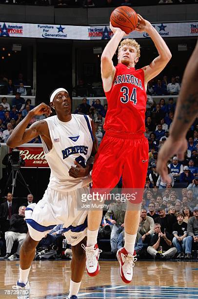 Chase Budinger of the Arizona Wildcats shoots a jump shot past Robert Dozier of the Memphis Tigers at FedExForum on December 29, 2007 in Memphis,...
