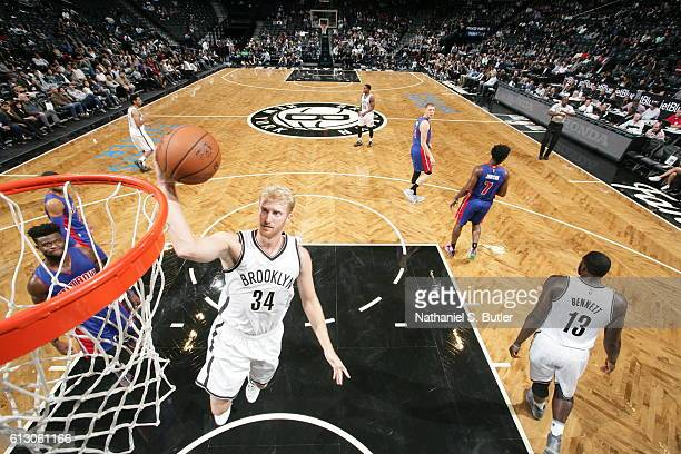 Chase Budinger of the Brooklyn Nets goes to the basket against the Detroit Pistons on October 6 2016 at Barclays Center in the Brooklyn borough of...