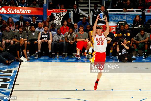 Chase Budinger of the Houston Rockets attempts a blind folder blind dunk in honor of the 20 year anniversary of Cedric Ceballos performing the same...