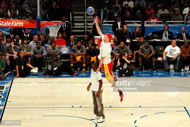 Chase Budinger of the Houston Rockets jumps over entertainer Sean 'PDiddy' Combs during the Sprite Slam Dunk Contest part of 2012 NBA AllStar Weekend...