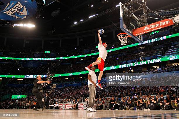 "Chase Budinger of the Houston Rockets jumps over entertainer Sean ""P.Diddy"" Combs during the Sprite Slam Dunk Contest part of 2012 NBA All-Star..."