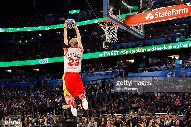 Chase Budinger of the Houston Rockets wearing a jersey for Cedric Ceballos of the Phoenix Suns dunks during the Sprite Slam Dunk Contest part of 2012...