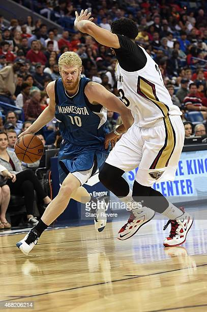 Chase Budinger of the Minnesota Timberwolves is defended by Anthony Davis of the New Orleans Pelicans during a game at Smoothie King Center on March...