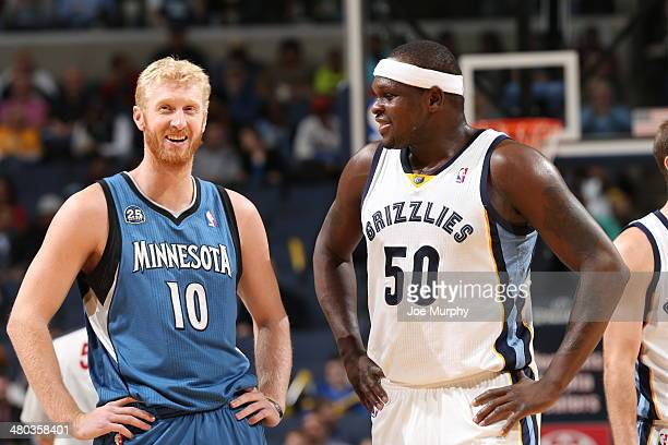 Chase Budinger of the Minnesota Timberwolves smiles with Zach Randolph of the Memphis Grizzlies on March 24 2014 at FedExForum in Memphis Tennessee...