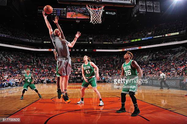 Chase Budinger of the Phoenix Suns goes to the basket against the Boston Celtics on March 26 2016 at Talking Stick Resort Arena in Phoenix Arizona...
