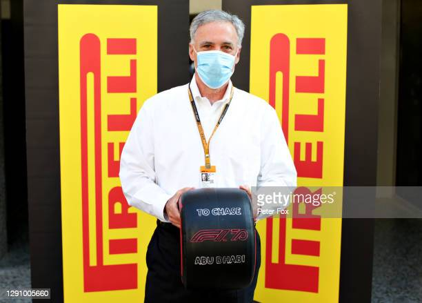 Chase Carey, CEO and Executive Chairman of the Formula One Group, is presented with a commemorative Pirelli tyre as he is set to leave his position...