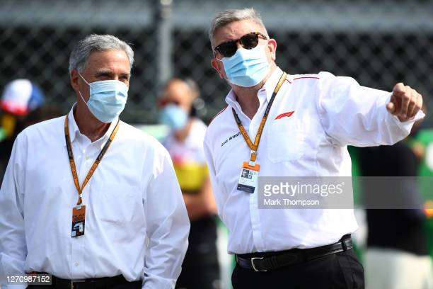 Chase Carey, CEO and Executive Chairman of the Formula One Group speaks with Ross Brawn, Managing Director of the Formula One Group prior to the F1...