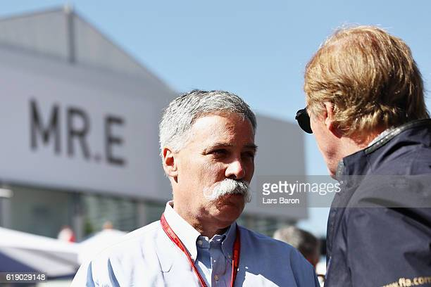 Chase Carey Chairman of Formula One Group talks to a member of the FIA in the Paddock during qualifying for the Formula One Grand Prix of Mexico at...
