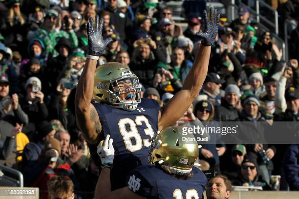 Chase Claypool and Chris Finke of the Notre Dame Fighting Irish celebrate after Claypool scored a touchdown in the first quarter against the Navy...