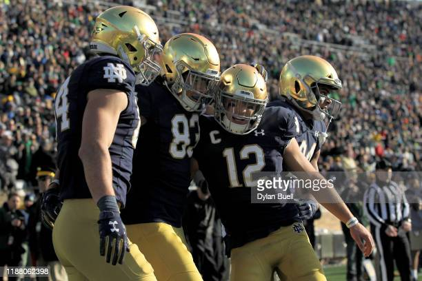 Chase Claypool and Ian Book of the Notre Dame Fighting Irish celebrate after scoring a touchdown in the first quarter against the Navy Midshipmen at...