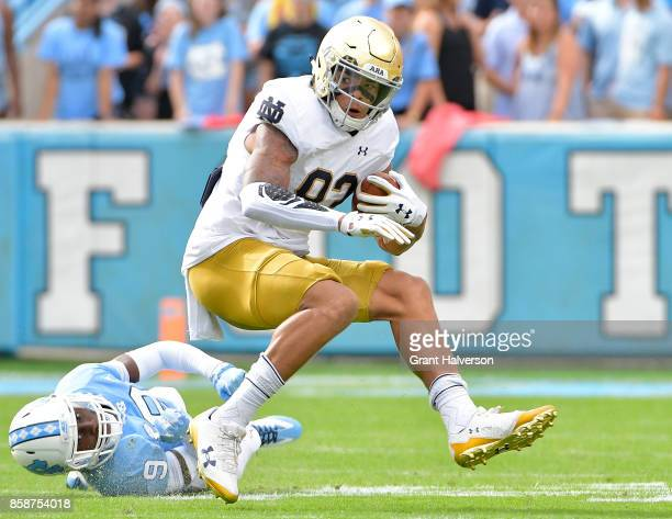 Chase Claypool of the Notre Dame Fighting Irish breaks away from KJ Sails of the North Carolina Tar Heels during the game at Kenan Stadium on October...