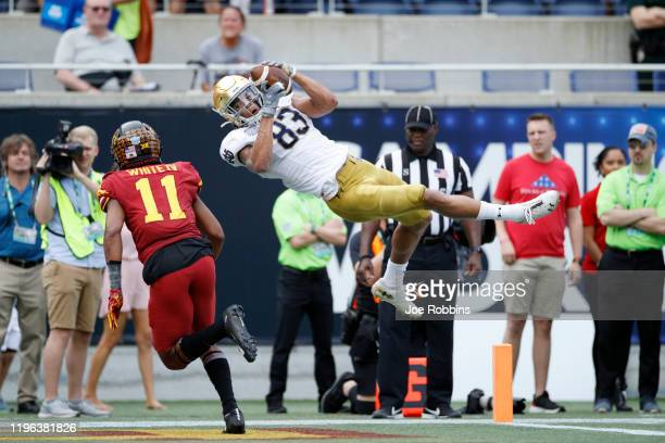 Chase Claypool of the Notre Dame Fighting Irish makes a diving catch in the end zone for a 24-yard touchdown in the first quarter of the Camping...