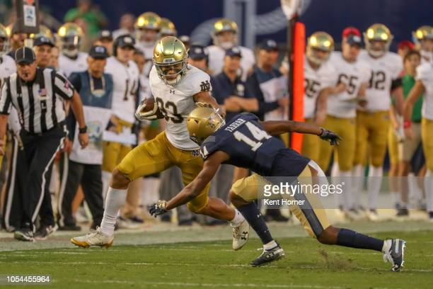 Chase Claypool of the Notre Dame Fighting Irish runs with the ball in the 1st half against Micah Farrar of the Navy Midshipmen at SDCCU Stadium on...