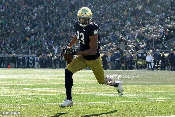 Chase Claypool of the Notre Dame Fighting Irish runs with the ball in the first quarter against the Navy Midshipmen at Notre Dame Stadium on November...
