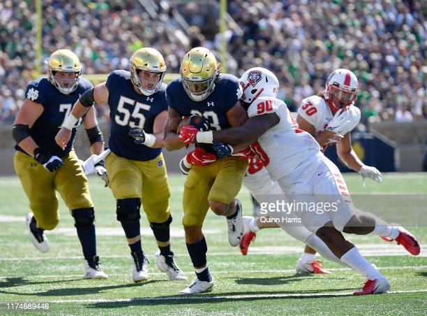 Chase Claypool of the Notre Dame Fighting Irish runs with the football in the second quarter against Erin Austin of the New Mexico Lobos at Notre...
