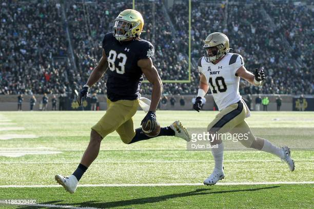 Chase Claypool of the Notre Dame Fighting Irish scores a touchdown past Kevin Brennan of the Navy Midshipmen in the first quarter at Notre Dame...