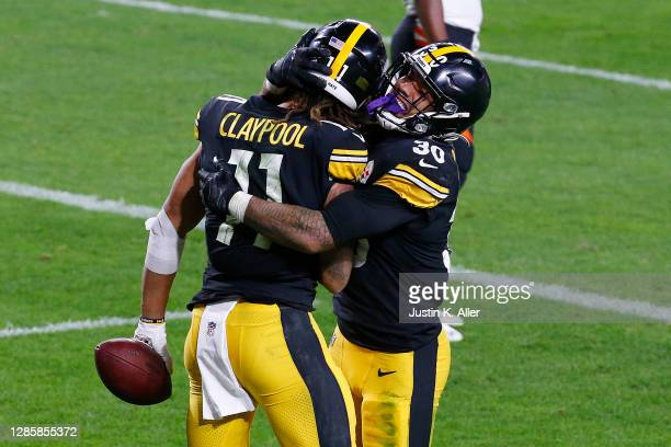 Chase Claypool of the Pittsburgh Steelers celebrates an 11-yard touchdown against the Cincinnati Bengals with James Conner during their NFL game at...