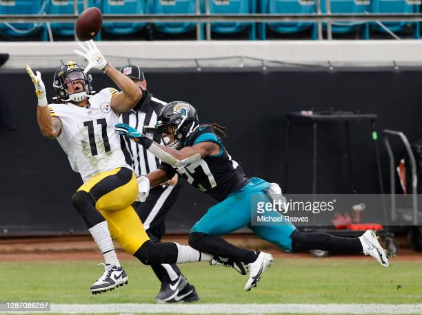Chase Claypool of the Pittsburgh Steelers makes a catch as Chris Claybrooks of the Jacksonville Jaguars defends during the first half at TIAA Bank...